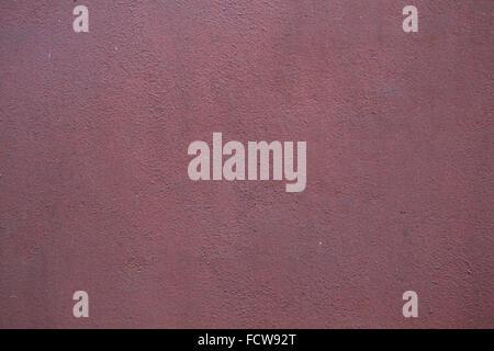 Burgund rot bemaltem Stuck Wand. Hintergrundtextur. - Stockfoto