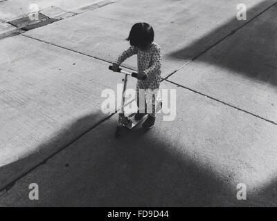 High Angle View Of Boy Push Motorroller