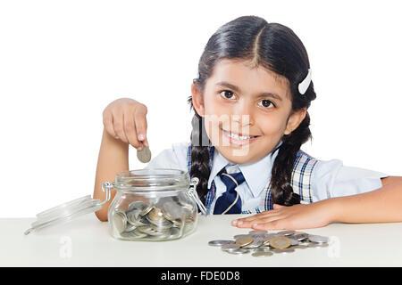 Nur 1 Person Münzen Mädchen junge sparschwein Rupien gespart Schule Smiling Student - Stockfoto