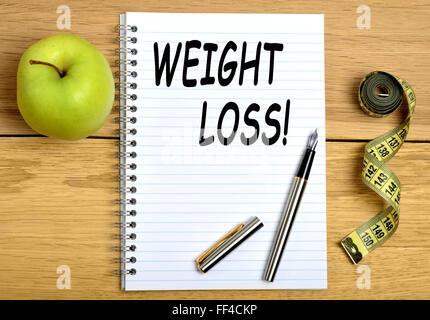 Gewicht-Verlust-Wörter auf notebook - Stockfoto