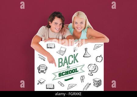 Zusammengesetztes Bild der schönen Mann zeigte auf einem Whiteboard mit Frau - Stockfoto