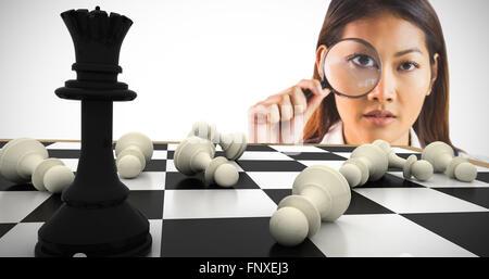 Zusammengesetztes Bild der Geschäftsfrau Blick durch die Lupe - Stockfoto