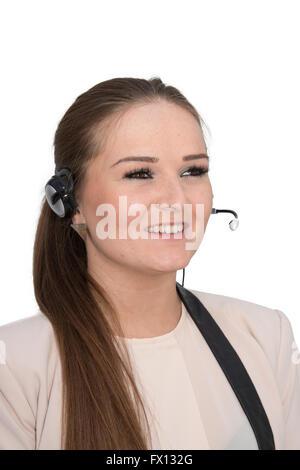 Eine freundliche Hilfe-Desk-Mitarbeiter im Gespräch mit einem Head-set - Stockfoto