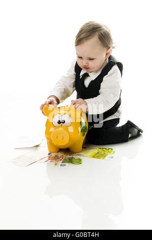 Geschäft Baby mit Sparschwein - Stockfoto