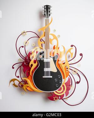 Sterne und wirbelt umgebende Papier Handwerk Gitarre - Stockfoto