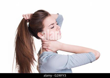 Junge Frau von Nackenschmerzen leiden - Stockfoto