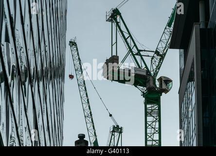 Baukräne in Stadt, Glasgow, Schottland, UK, Stockfoto