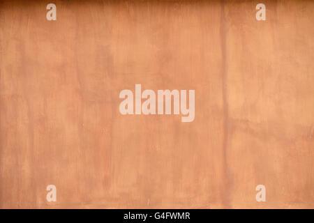 Nahaufnahme Detail rustikal strukturierte Terrakotta farbigen Stuck Wand Hintergrund - Stockfoto