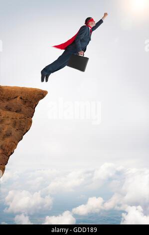 geschäftlichen Erfolg Konzept Superhelden Geschäftsmann fliegen - Stockfoto