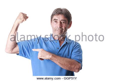 Senior woman zeigt Muskeln - Stockfoto