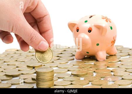 Hand zu retten Münzen - Stockfoto