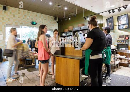 Naples Florida Coastland Center Shopping Mall Einkaufszentrum Kaffee von Starbucks coffeehouse Kette um Verkäufer - Stockfoto