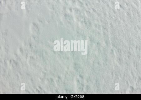 Die Textur des kleinen dünnen Schnee auf Eis - Stockfoto