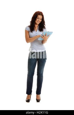 Eine Geschäftsfrau, die Spaß mit einer Tablette. - Stockfoto
