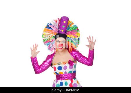 Lustiges Mädchen Clown mit einem großen bunten Perücke isolierten auf weißen Hintergrund - Stockfoto