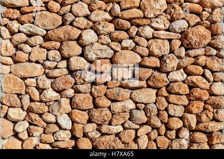 Steinerne Mauer Steine von verschiedenen Formen und Größen, steinigen Wandstruktur - Stockfoto