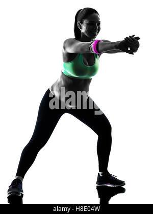 eine kaukasische schwangere Frau, die Ausübung von Fitness-Übungen in Silhouette Studio isoliert auf weißem Hintergrund - Stockfoto