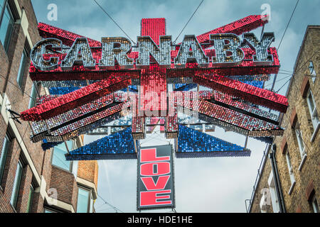 Weihnachtsbeleuchtung auf der Carnaby Street, London, UK - Stockfoto