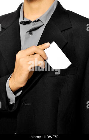 Business-Mann, indem eine leere Visitenkarte in seinem Anzug Tasche - Stockfoto