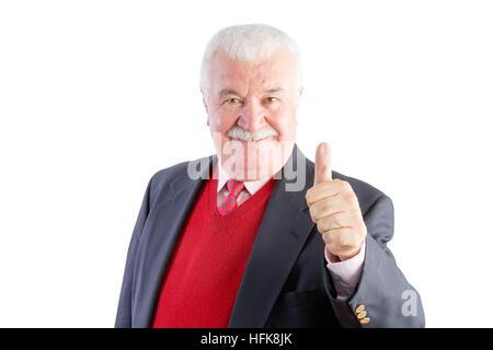 Freche Senior gibt einen Daumen nach oben und lächelt in die Kamera während des Tragens eines Business-Anzug - Stockfoto