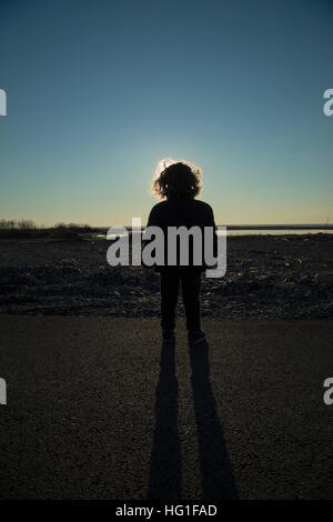 Silhouette-Kinder am Himmel Sonnenuntergang - Stockfoto