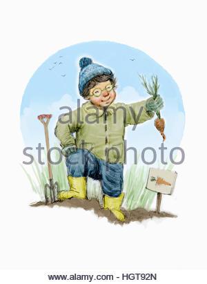 Fröhlicher Junge Karotten im Garten umgraben - Stockfoto