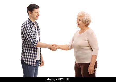 Junger Mann Händeschütteln mit einer älteren Frau isoliert auf weißem Hintergrund - Stockfoto