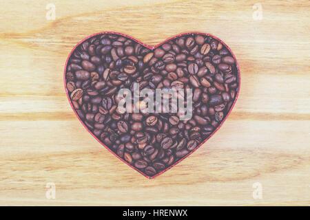 Kaffeebohnen mit Herzform - Stockfoto