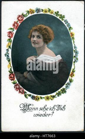 Eine Postkarte gedruckt in Deutschland, zeigt ein Porträt einer schönen Frau. Die Inschrift in deutscher Sprache: - Stockfoto