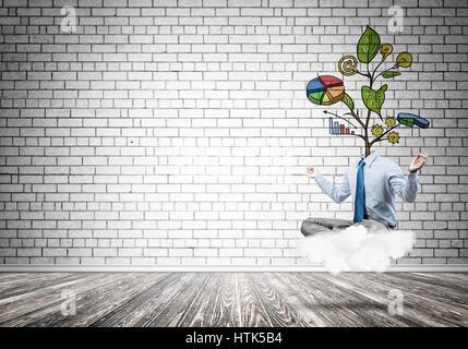 Kopflose Geschäftsmann meditieren - Stockfoto