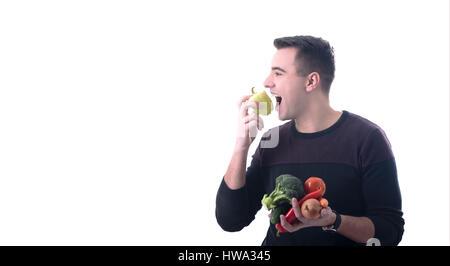 Junger Mann liebt Essen Gemüse weißen Hintergrund - Stockfoto