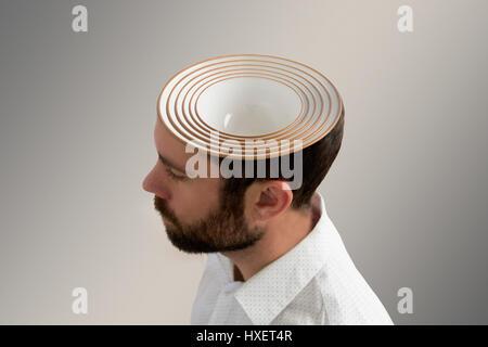 Mehreren Keramikschalen im Kopf eines Mannes - Stockfoto