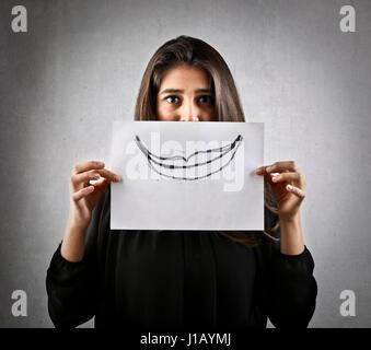 Frau mit gezogenen Mund auf Papier - Stockfoto