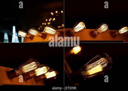Edison Glühlampe hängt an einem langen Draht. Gemütliche warme gelbe Licht - Stockfoto