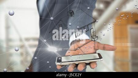 Digital Composite Mittelteil der Unternehmerpersönlichkeit mit Haus über Smartphone - Stockfoto