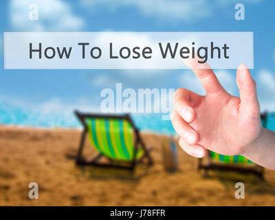 Wie man Gewicht verlieren - Hand drücken einer Taste auf unscharfen Hintergrund Konzept. Wirtschaft, Technologie, - Stockfoto