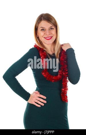 Bild einer schönen jungen Frau, die durch Weihnachten Dekoration auf einem isolierten Hintergrund abgerundet - Stockfoto