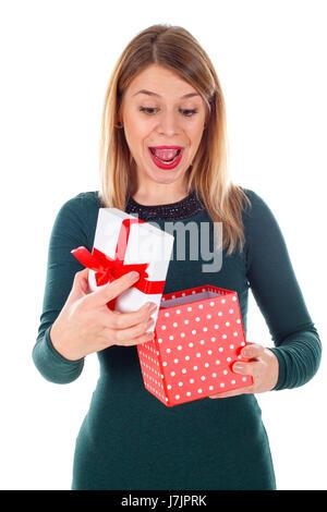 Bild einer überascht junge Frau mit ihrem Weihnachtsgeschenk - Stockfoto