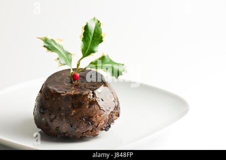foto von einem christmas pudding mit holly an der spitze. Black Bedroom Furniture Sets. Home Design Ideas
