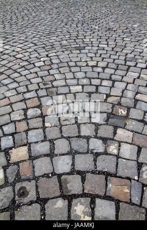 Nahaufnahme von einer Straße mit Kopfsteinpflaster - Stockfoto