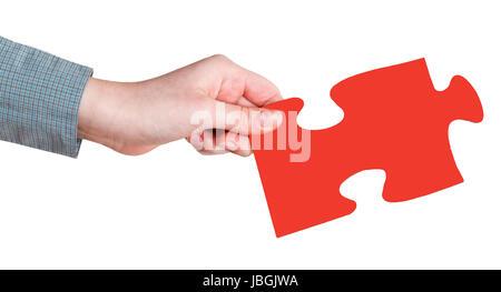 weibliche Hand mit roten Puzzleteil isoliert auf weißem Hintergrund - Stockfoto