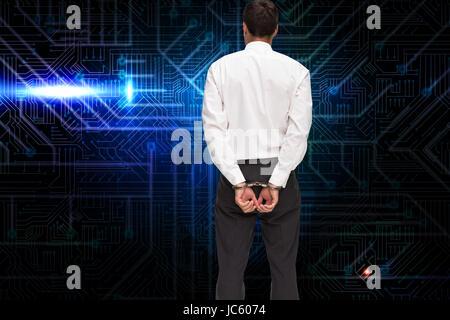 Zusammengesetztes Bild der Rückansicht der junge Geschäftsmann tragen Handschellen - Stockfoto