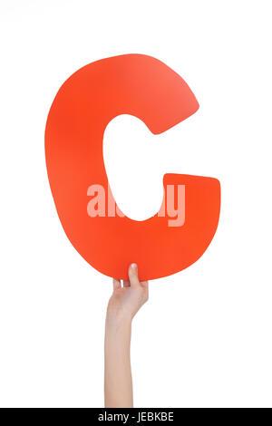Kind hält in der hand bunte Alphabet Buchstaben C isoliert, Alphabet Buchstaben Konzept - Stockfoto