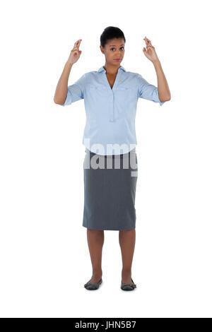 Porträt der Geschäftsfrau hält ihre Finger gekreuzt - Stockfoto