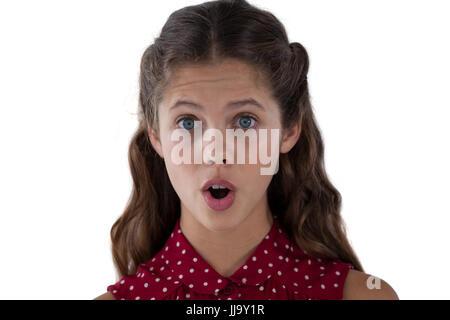 Porträt von überrascht Teenager-Mädchen stehen auf weißen Hintergrund - Stockfoto