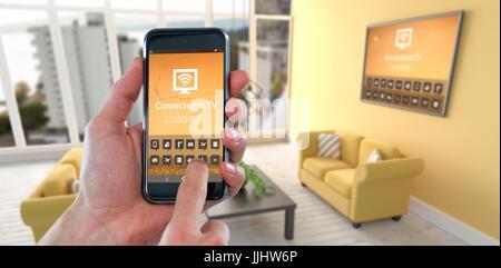 Hand mit Handy gegen digitales Bild des modernen Wohnzimmer beschnitten - Stockfoto