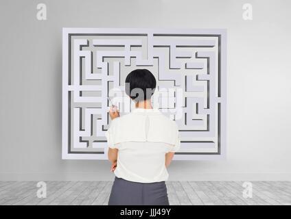 Frau auf der Suche um ein Labyrinth an der Wand 3d - Stockfoto