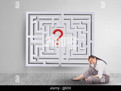Frau sitzt auf dem Boden mit einem 3d Labyrinth hinter - Stockfoto