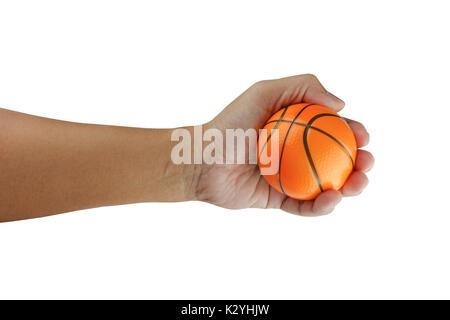 Kleinen korb Ball in Hand auf weißem Hintergrund mit Freistellungspfad isoliert - Stockfoto