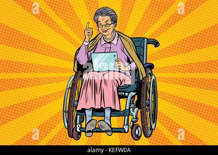 Ältere Frau behinderte Person in einem Rollstuhl, gadget Tablet - Stockfoto